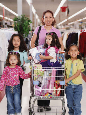 Hispanic family with shopping cart in department store