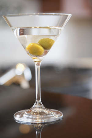 Close up of martini with olives