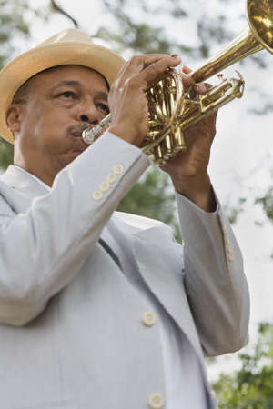 Senior African man playing trumpet LANG_EVOIMAGES