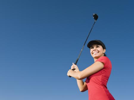 Native American swinging golf club