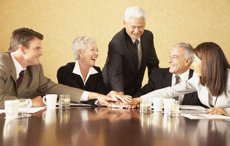 Group of businesspeople at conference table LANG_EVOIMAGES