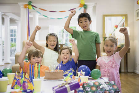 Children cheering at birthday party