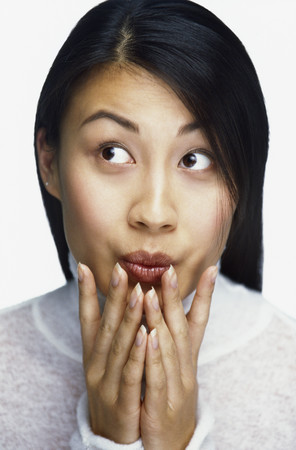 Asian woman looking surprised
