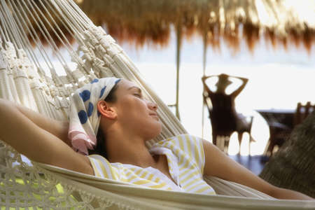 Pacific Islander woman sleeping in hammock