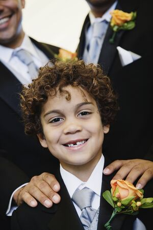 Hispanic boy wearing tuxedo