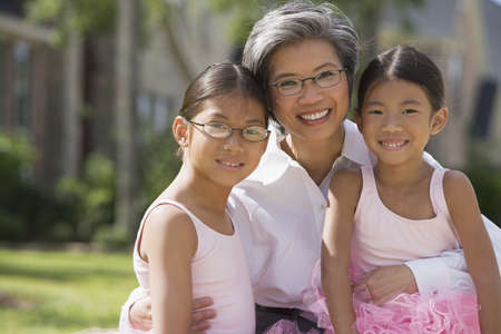 Asian mother and daughters in ballet outfits