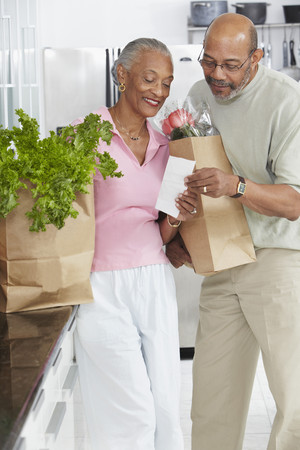 African couple grocery shopping
