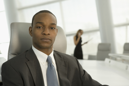 Close up of African businessman in conference room LANG_EVOIMAGES