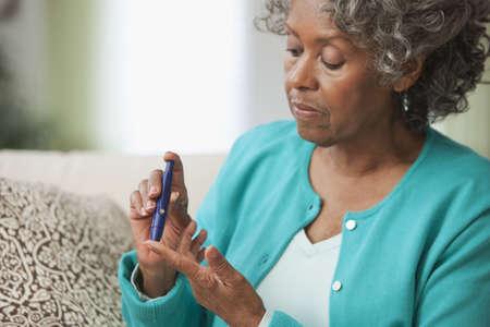 African woman using diabetes test kit