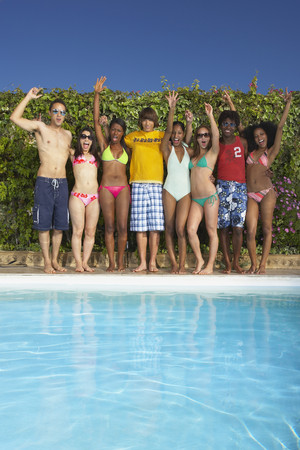 Multi-ethnic group of friends enjoying pool party LANG_EVOIMAGES