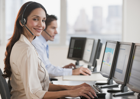 Hispanic businesswoman working on computer LANG_EVOIMAGES