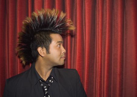 Pacific Islander man with mohawk