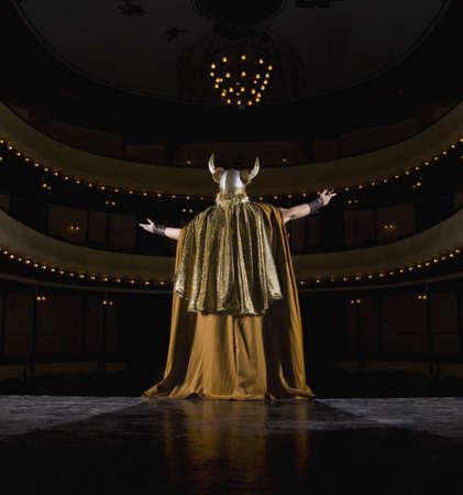 Female opera singer singing on stage LANG_EVOIMAGES