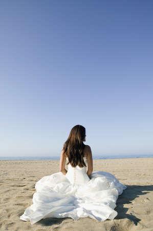 Hispanic bride at beach LANG_EVOIMAGES