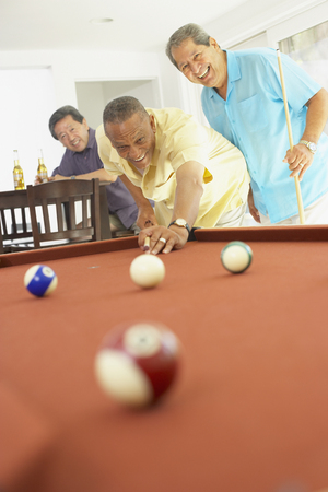 Multi-ethnic group of friends playing pool LANG_EVOIMAGES