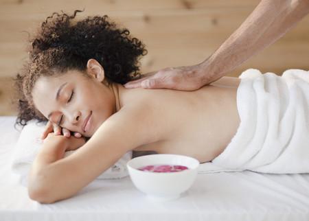 Mixed race woman receiving massage