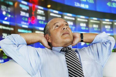 Hispanic businessman at stock exchange LANG_EVOIMAGES