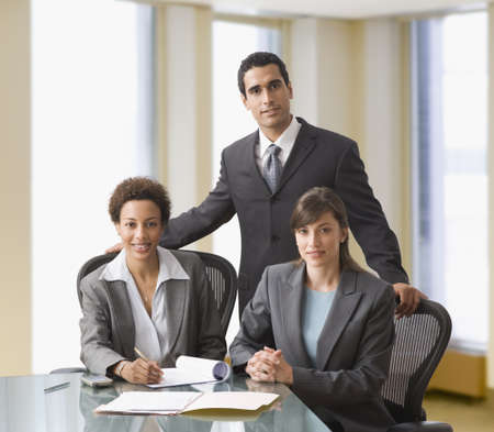 Multi-ethnic businesspeople at conference table