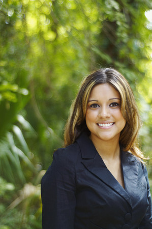 Hispanic businesswoman posing outdoors LANG_EVOIMAGES