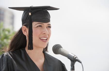 Hispanic valedictorian giving speech LANG_EVOIMAGES