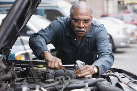 African man working on car