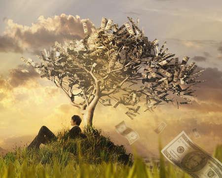 Businessman sitting under money tree
