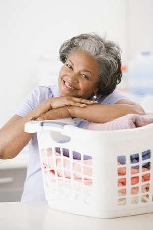 African woman folding laundry