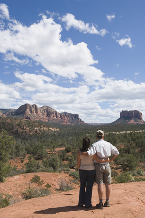 Multi-ethnic senior couple looking at desert landscape LANG_EVOIMAGES