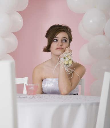 Bored Hispanic girl at prom