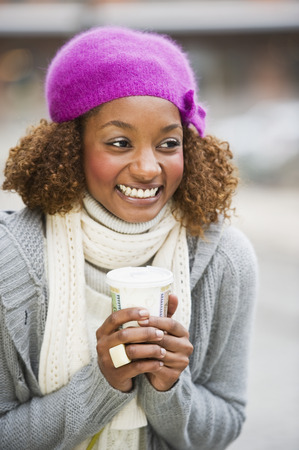 Mixed race woman drinking coffee LANG_EVOIMAGES