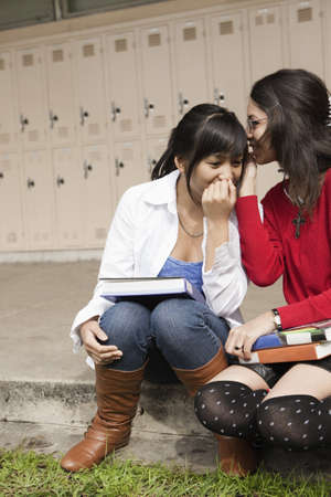 Students telling secrets in school