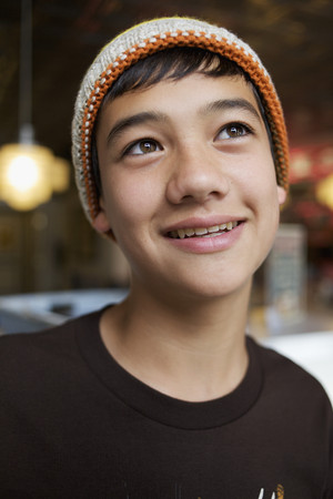 Mixed race boy in cap, smiling