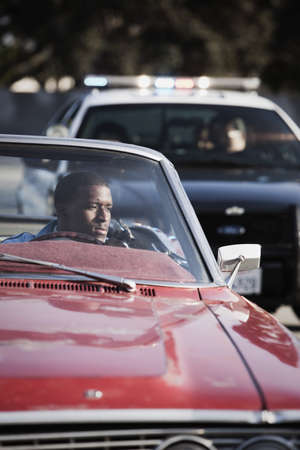 African man in convertible being pulled over by police LANG_EVOIMAGES