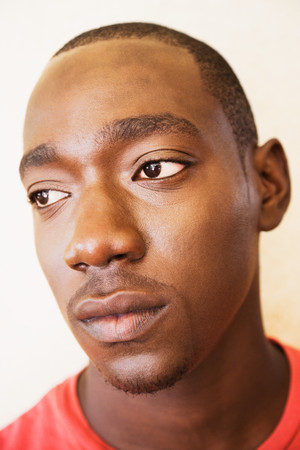 Close up of serious African man LANG_EVOIMAGES