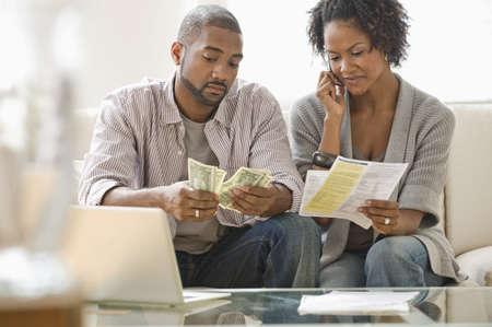Black couple paying bills LANG_EVOIMAGES