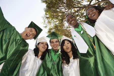 Shouting high school graduates hugging