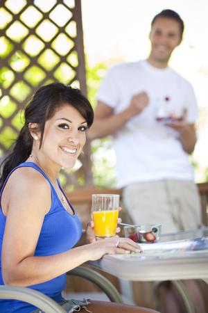 Couple eating breakfast on patio