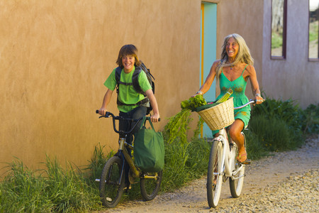 Caucasian grandmother and grandson riding bicycles