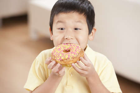 Korean boy eating donut