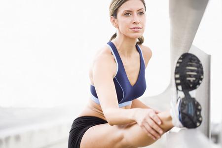 Hispanic woman stretching before exercise