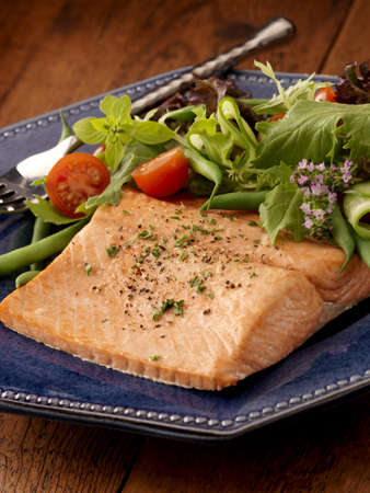 Coho salmon served with green salad