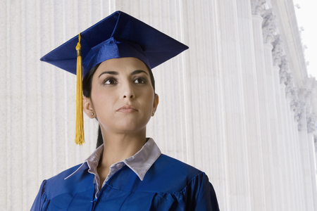 Graduating Turkish woman in mortarboard and cap and gown