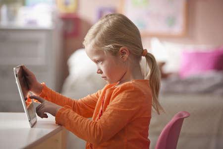 Caucasian girl using digital tablet