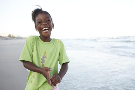 Laughing Jamaican girl on beach