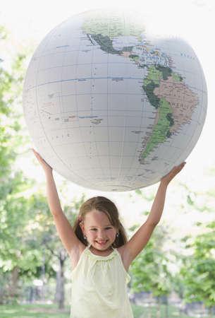 Girl holding large globe