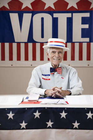 Caucasian man working at registration desk of polling place