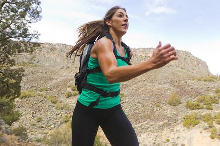 Hispanic runner training in remote area LANG_EVOIMAGES