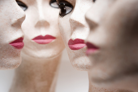 Four female mannequin heads LANG_EVOIMAGES