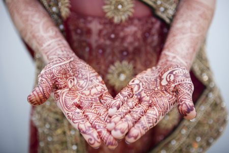 Caucasian woman with Indian henna tattoos on her hands LANG_EVOIMAGES