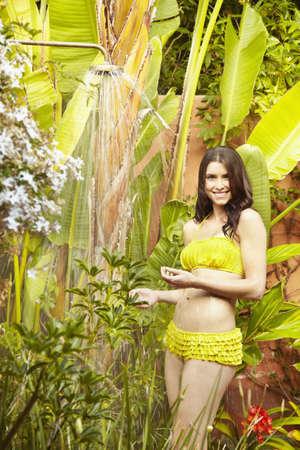 Caucasian woman in bikini showering outdoors LANG_EVOIMAGES